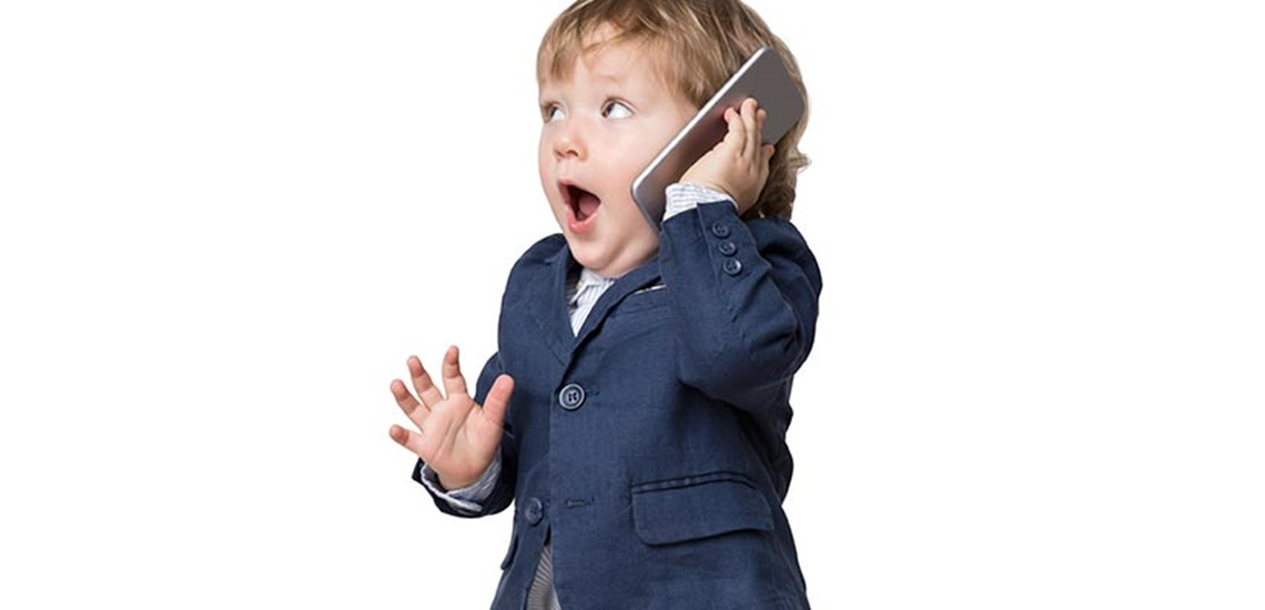 a child is surprised while talking on the phone
